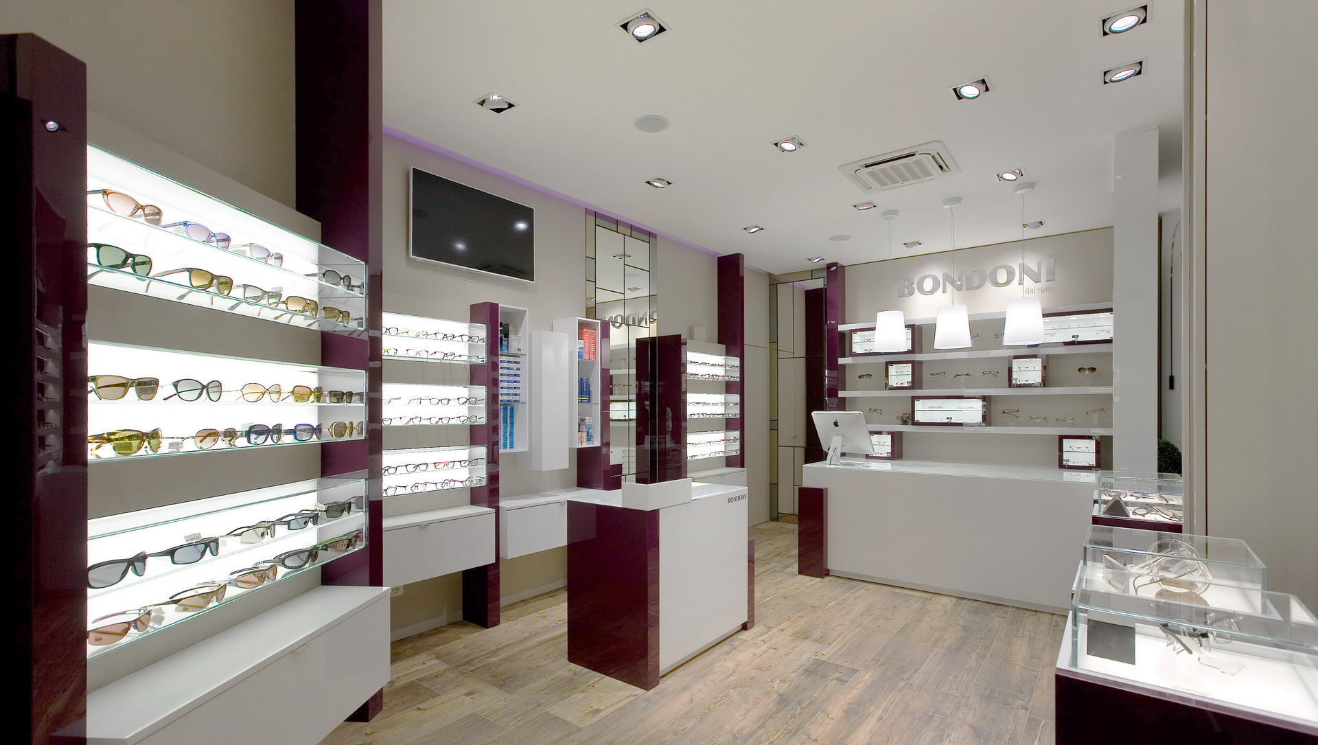 Arredamento ottica bondoni negozio di ottica milano for Arredamento negozi